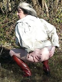 Brunette mature pissing and posing naked outdoor