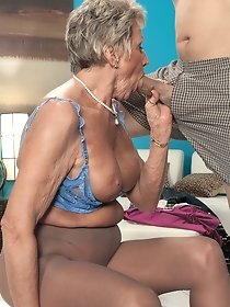 Blonde granny in stockings sucks hot dick