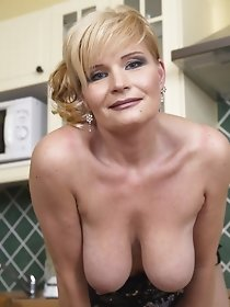 This hot housewife loves to play with her pussy in her kitchen