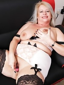 Naughty chubby British housewife showing off her goods