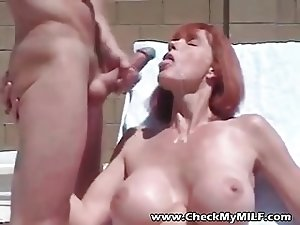 Hot Busty MILF with gorgeous body slurping on cock