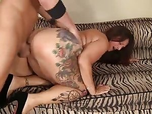 Big wobbly tattooed milf