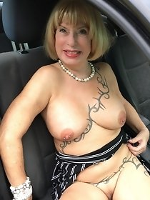 Gorgeous blonde shows pussy in the car