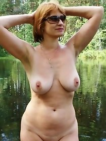 Redhead mature on a beautiful lake
