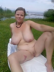 Naked old whores are resting outdoor