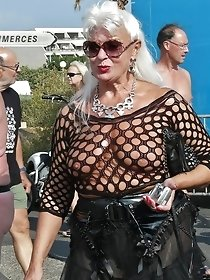 Busty gorgeous cougar poses in public