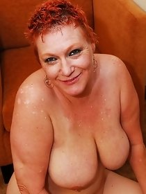 Busty redhead mom in hot sauna