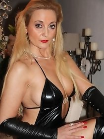 Charming mature blonde in black latex