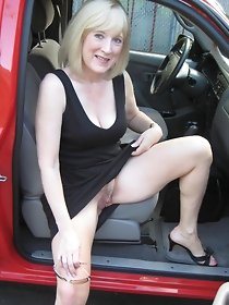 Blonde lady masturbates in red car