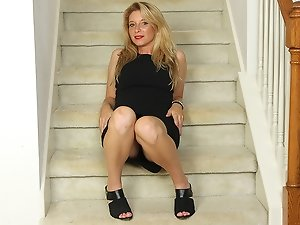 Naughty American MILF playing with her pussy on the stairs