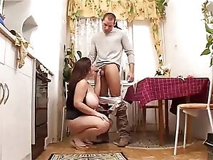 BBW  with big tits fucking in kitchen with young man