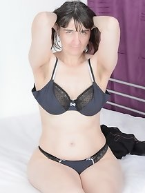 Hot Milf-Pussy On The Bed Pictures